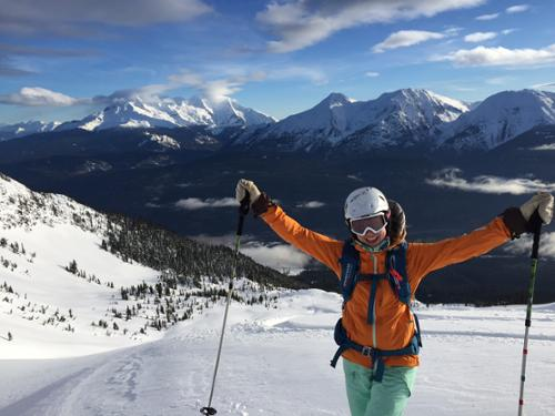 Krista Crabtree celebrates while heliskiing with White Wilderness Heliskiing in Canada.