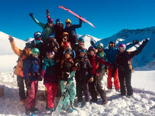 A group of women celebrate the ski day and blue sky at Silverton Mountain.
